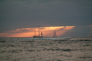 Sunset off the beach at Outrigger Reef Waikiki Beach Resort
